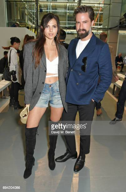 Doina Ciobanu and Jack Guinness attend the Oliver Spencer SS18 Catwalk Show during London Fashion Week Men's June 2017 on June 9 2017 in London...