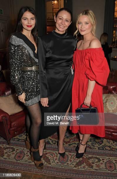 Doina Ciobanu, CEO of the British Fashion Council Caroline Rush and Laura Whitmore attend The Fashion Awards 2019 cocktail reception to celebrate the...