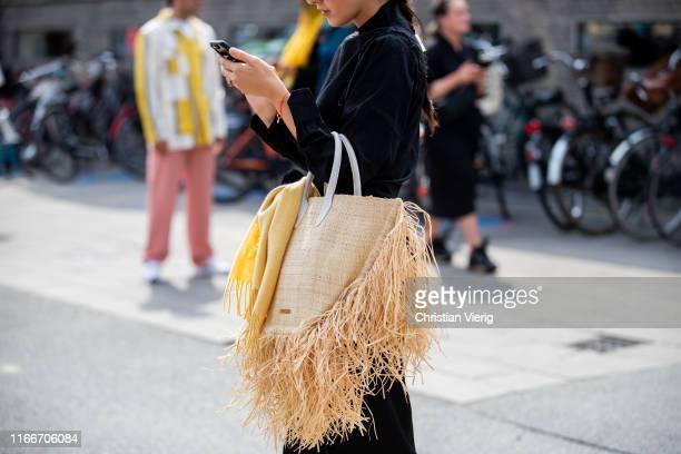 Doina Ciobanu is seen wearing black dress, Jacquemus bag outside Holzweiler during Copenhagen Fashion Week Spring/Summer 2020 on August 07, 2019 in...