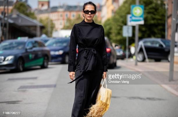 Doina Ciobanu is seen wearing black dress Jacquemus bag outside Holzweiler during Copenhagen Fashion Week Spring/Summer 2020 on August 07 2019 in...