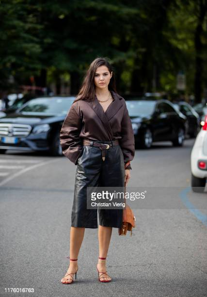 Doina Ciobanu is seen wearing black leather pants, brown blazer outside the Tod's show during Milan Fashion Week Spring/Summer 2020 on September 20,...