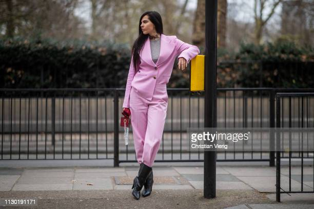Doina Ciobanu is seen wearing pink suit outside Halpern during London Fashion Week February 2019 on February 16 2019 in London England