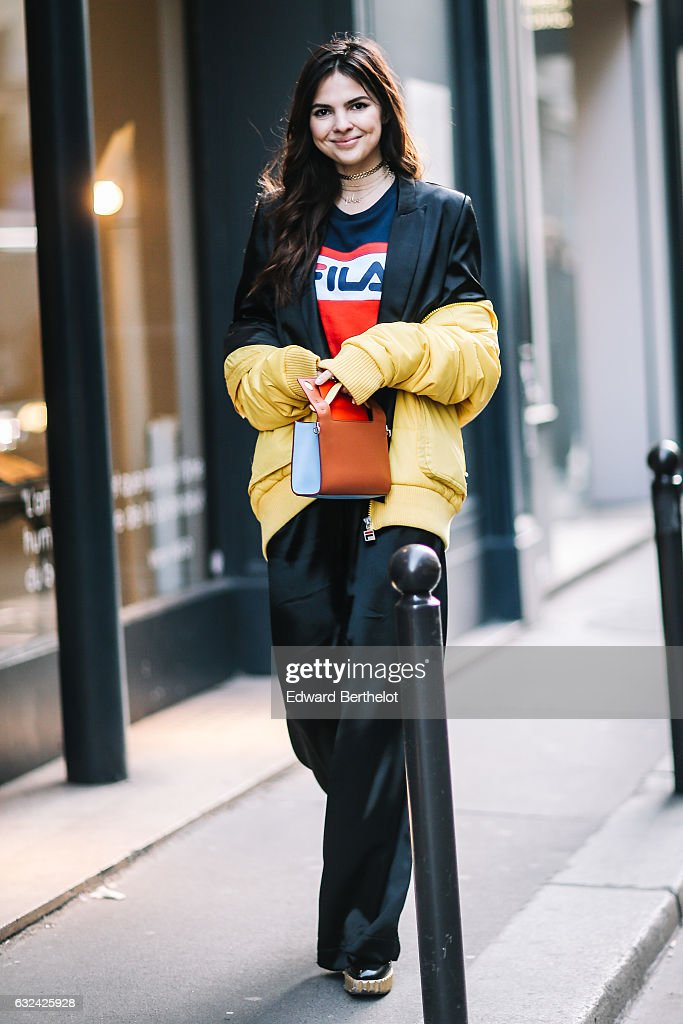 Doina Ciobanu is wearing a yellow bomber jacket, a black suit, a Fila t-shirt, outside the Paul Smith show, during Paris Fashion Week Menswear Fall/Winter 2017/2018, on January 22, 2017 in Paris, France.
