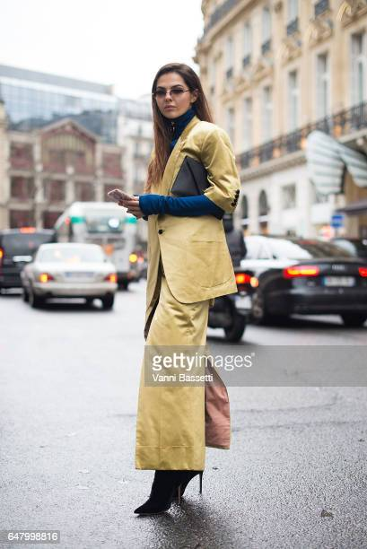 Doina Ciobanu poses wearing Vivienne Westwood after the Vivienne Westwood show at the Hotel Intercontinental on March 4 2017 in Paris France