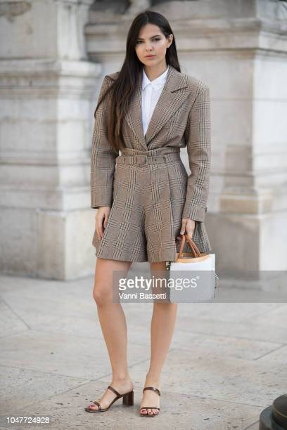 Doina Ciobanu poses with a Danse Lente bag after the Stella McCartney show at the Opera Garnier during Paris Fashion Week SS19 Womenswear on October...