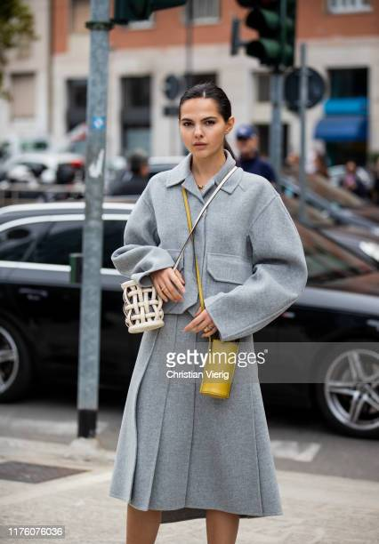 Doina Ciobanu seen wearing grey jacket skirt with slit drinking bottle bag outside the Sportmax show during Milan Fashion Week Spring/Summer 2020 on...