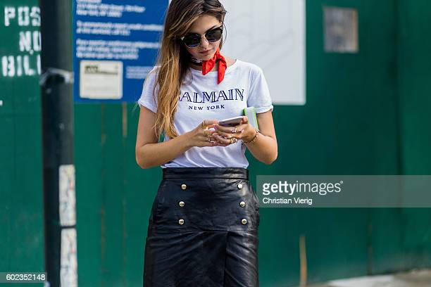 Doina Ciobanu wearing a Balmain thsirt scarf leather skirt outside Dion Lee on September 10 2016 in New York City