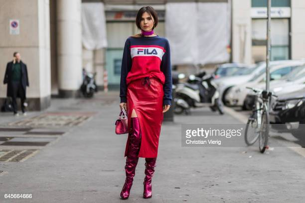 Doina Ciobanu wearing a Fila sweater red leather skirt Louboutin overknees outside Salvatore Ferragamo during Milan Fashion Week Fall/Winter 2017/18...