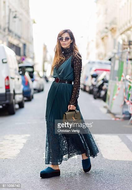 Doina Ciobanu wearing a green dress sheer top Louis Vuitton bag outside Dries van Noten on September 28 2016 in Paris France