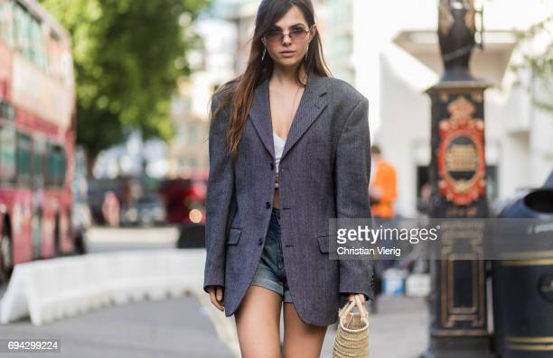 Doina Ciobanu wearing a grey blazer jacket denim shorts during the London Fashion Week Men's June 2017 collections on June 9 2017 in London England