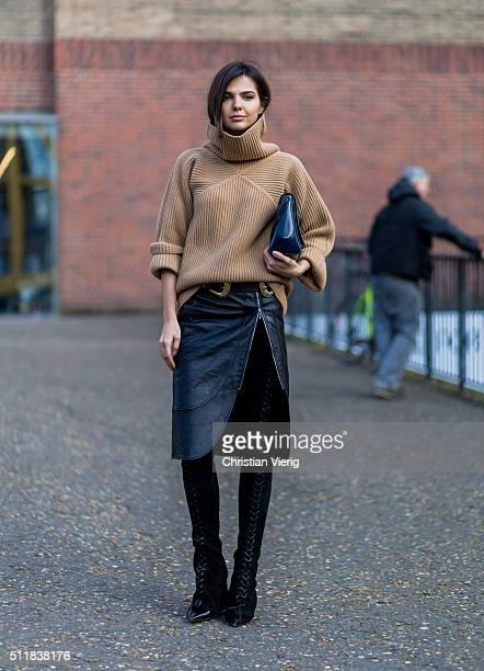 Doina Ciobanu wearing a Paul Smith turtleneck Christopher Kane bag Dimitri leather skirt seen outside Christopher Kane during London Fashion Week...