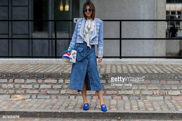Doina Ciobanu wearing a white Dior bag Temperley London blazer Ruban skirt Rejina Pyo shoes outside Preen during London Fashion Week Spring/Summer...