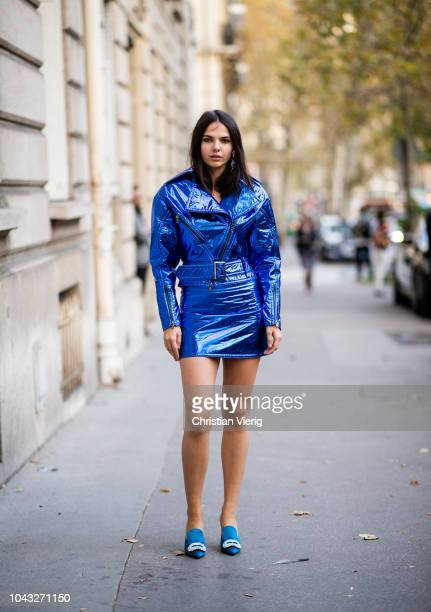 Doina Ciobanu wearing blue vinyl jacket and mini skirt is seen outside Alessandra Rich during Paris Fashion Week Womenswear Spring/Summer 2019 on...