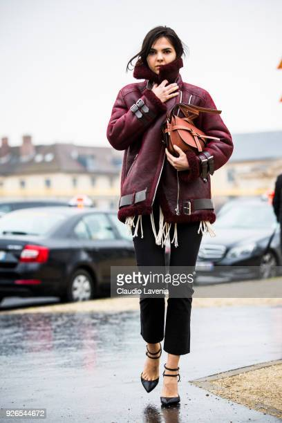 Doina Ciobanu wearing brown aviator jacket and Loewe Gate bag is seen in the streets of Paris before the Loewe show during Paris Fashion Week...
