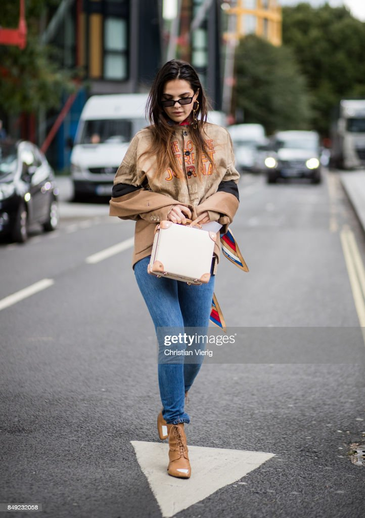 Doina Ciobanu wearing brown top, denim jeans, ankle boots outside Christopher Kane during London Fashion Week September 2017 on September 18, 2017 in London, England.