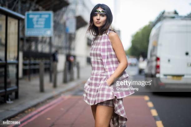 Doina Ciobanu wearing checked dress outside Pringle of Scotland during London Fashion Week September 2017 on September 18 2017 in London England