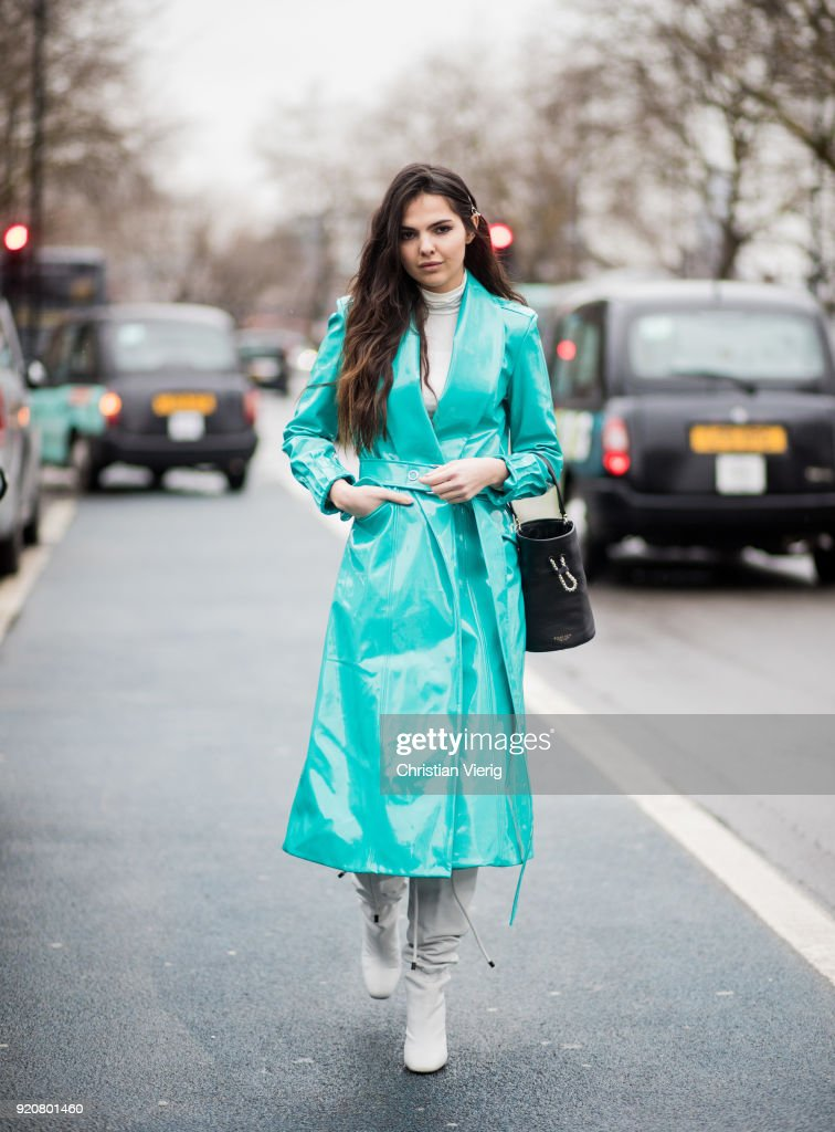 Doina Ciobanu wearing colorful vinyl coat seen outside Christopher Kane during London Fashion Week February 2018 on February 19, 2018 in London, England.