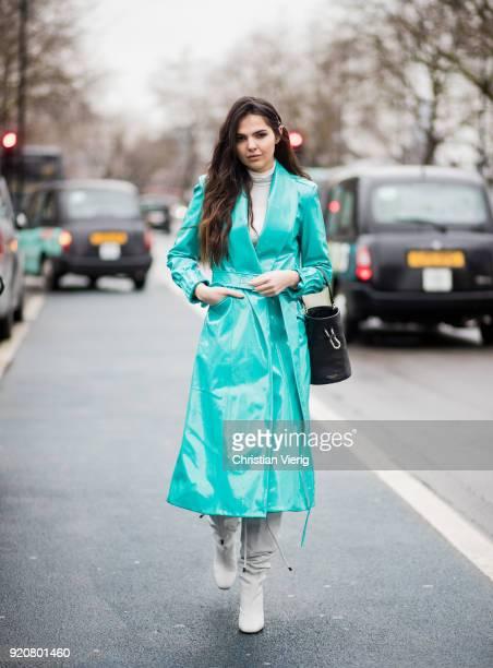Doina Ciobanu wearing colorful vinyl coat seen outside Christopher Kane during London Fashion Week February 2018 on February 19 2018 in London England