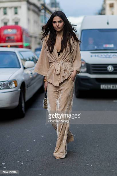 Doina Ciobanu wearing Dior bag Gestuz suit and Jimmy Choo shoes during London Collections Men AW16 on January 10 London England