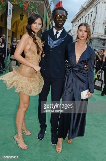 Doina Ciobanu, wearing Jean-Louis Sabaji Couture,, Wilson Oryema and Danielle Copperman attend The Green Carpet Fashion Awards Italia 2018 at Teatro...