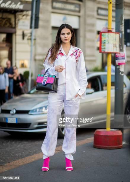 Doina Ciobanu wearing Paula Cademartori bag Pucci button shirt Gianvitto Rossi heels pink socks is seen outside Philosophy during Milan Fashion Week...