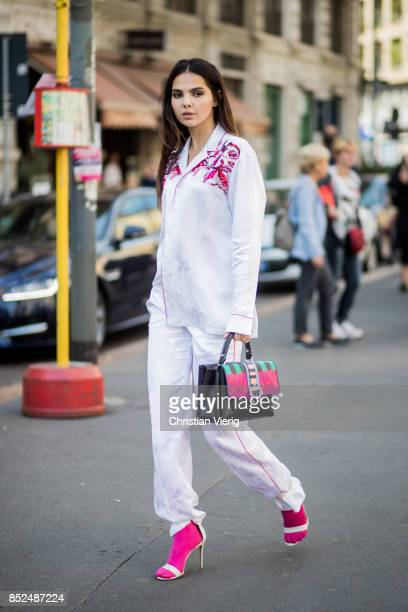 Doina Ciobanu wearing Paula Cademartori bag Pucci button shirt Gianvitto Rossi heels pink socks is seen outside Philosophy during Milan Fashion Week...