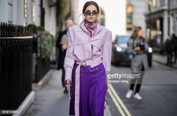 Doina Ciobanu wearing pink jacket purple skirt heels bag seen outside Mulberry during London Fashion Week February 2018 on February 16 2018 in London...