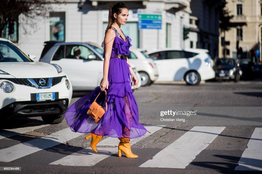 Doina Ciobanu wearing purple dress is seen outside Alberta Ferretti during Milan Fashion Week Spring/Summer 2018 on September 20, 2017 in Milan, Italy.