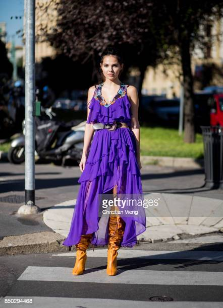 Doina Ciobanu wearing purple dress is seen outside Alberta Ferretti during Milan Fashion Week Spring/Summer 2018 on September 20 2017 in Milan Italy
