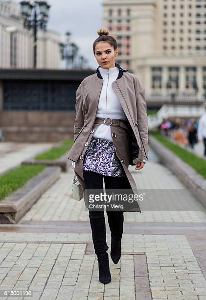 Doina Ciobanu wearing Saint Tokyo trench coat and overknees on October 15 2016 in Moscow Russia