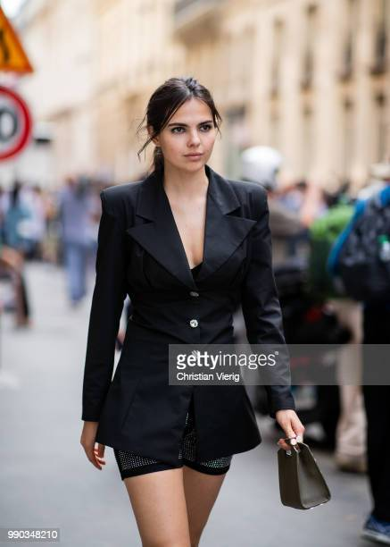 Doina Ciobanu wearing shorts bike rider pants black blazer is seen outside Ralph Russo on day two during Paris Fashion Week Haute Couture FW18 on...