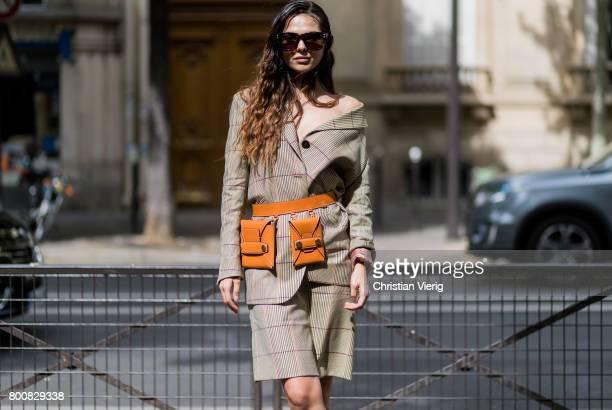 Doina Ciobanu wearing Stella McCartney belt bag brown boots checked skirt and blazer outside Paul Smith during Paris Fashion Week Menswear...