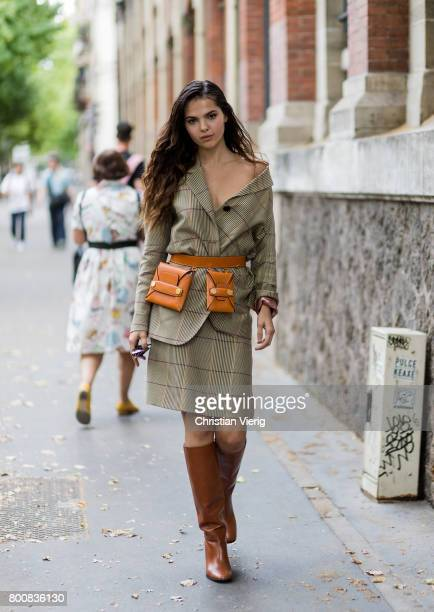 Doina Ciobanu wearing Stella McCartney belt bag brown boots checked skirt and blazer outside Paul Smith during Paris Fashion Week Menswear...