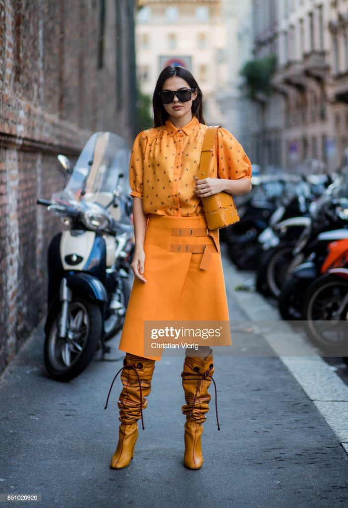 Doina Ciobanu wearing yellow orange blouse and skirt, noots is seen outside Max Mara during Milan Fashion Week Spring/Summer 2018 on September 21, 2017 in Milan, Italy.