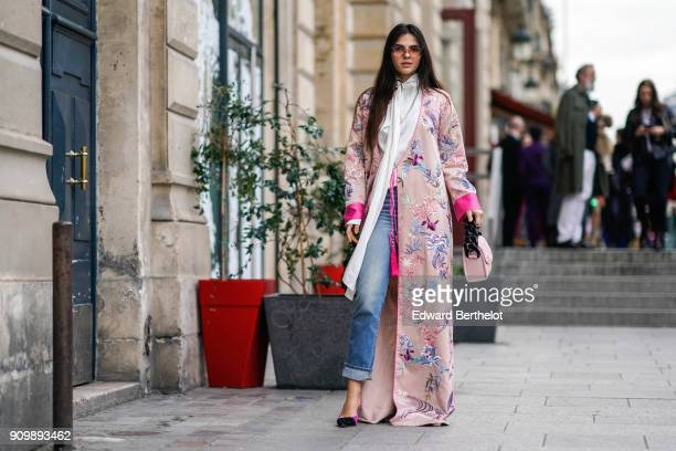 Doina Ciobanu wears a pink flower print kimono outfit blue jeans purple shoes a pink bag outside Viktor Rolf during Paris Fashion Week Haute Couture...