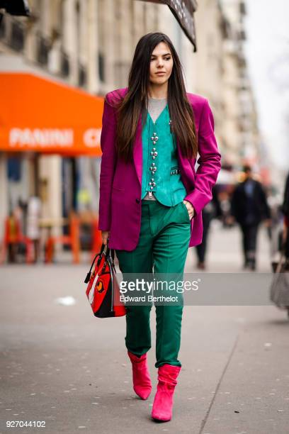Doina Ciobanu wears a purple blazer jacket a blue shirt green pants during Paris Fashion Week Womenswear Fall/Winter 2018/2019 on March 3 2018 in...