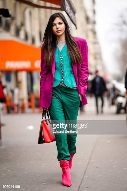 Doina Ciobanu wears a purple blazer jacket a blue shirt green pants during Paris Fashion Week Womenswear Fall/Winter 2018/2019 on March 3 2018 in...