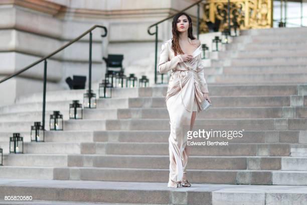 Doina Ciobanu wears a silk dress outside the amfAR dinner at Petit Palais during Paris Fashion Week Haute Couture Fall/Winter 20172018 on July 2 2017...