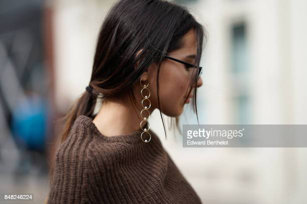 Doina Ciobanu wears earrings outside JW Anderson during London Fashion Week September 2017 on September 16 2017 in London England