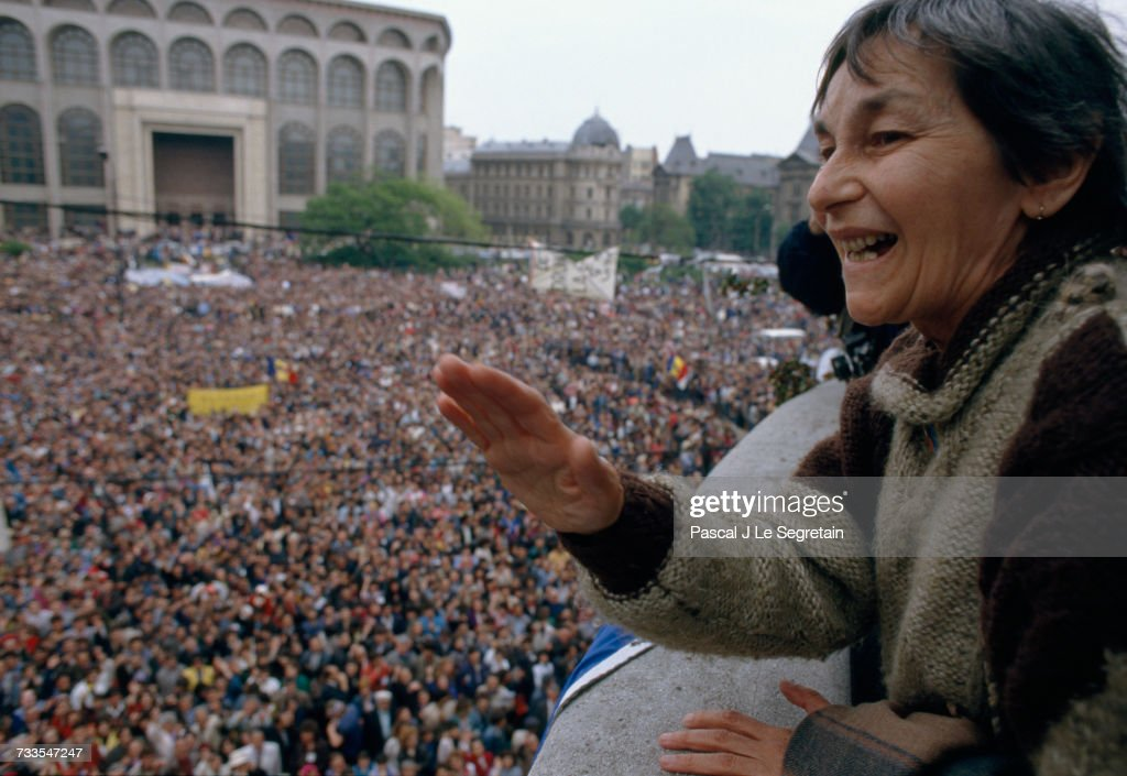 Doina Cornea, a prominent anti-Communist activist, looks over the massive crowd of people attending a May Day preelection demonstration at the University of Bucharest. The Romanian elections of 1990, the first free elections since 1937, brought out many vocal citizens frustrated with the National Salvation Front (NSF), the coalition of groups running the country since the overthrow of dictator Nicolae Ceausescu.