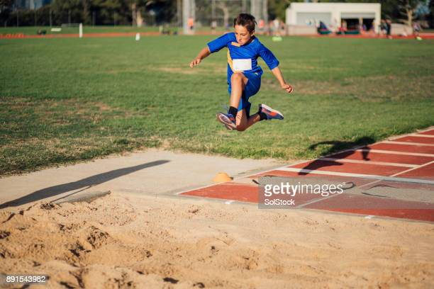 Doing A Long Jump In Athletics Club
