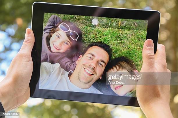 doing a selfie with my family on tablet - nephew stock pictures, royalty-free photos & images