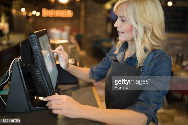 doing bill - cash register stock pictures, royalty-free photos & images