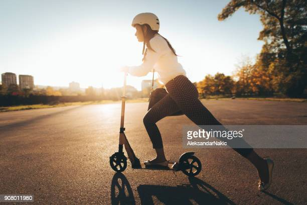 doing business on my push scooter - scooter stock pictures, royalty-free photos & images