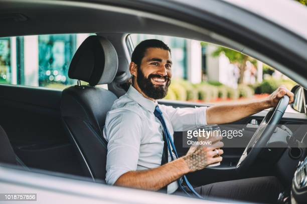 doing business while on the move - taxi driver stock photos and pictures