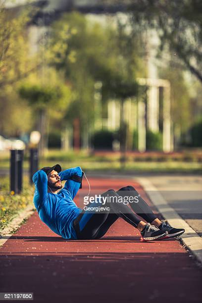 Doing crunches outdoors