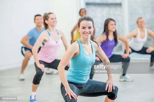 doing deep squats at the gym - women wearing spandex stock photos and pictures