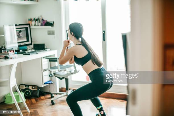 doing exercise at home - home workout stock pictures, royalty-free photos & images