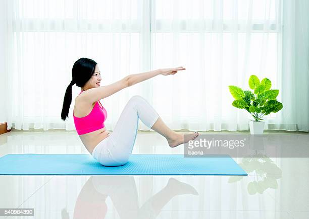 doing exercise at home - asian six pack stock photos and pictures