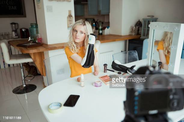 doing her makeup - amputee girl stock pictures, royalty-free photos & images